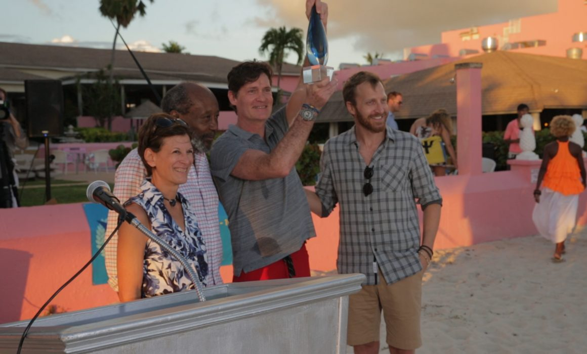 Craig Leeson accepts award at the Barbados Independent Film Festival