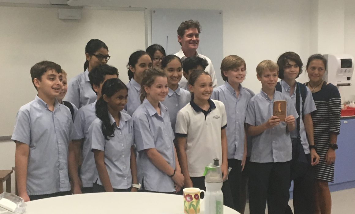 Craig Leeson with students in Singapore