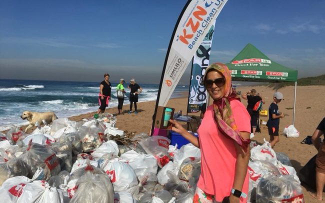Loyal KZN Beach Clean Up volunteer Aneesa Pandor with a reusable bamboo ecoffee cup.