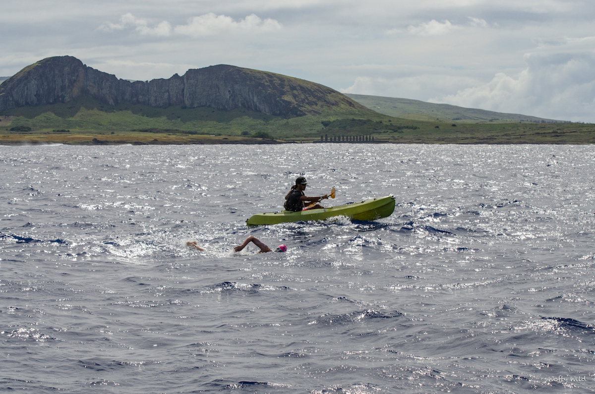 Sarah Ferguson swimming past Easter Island's Moai statues of Tongariki.