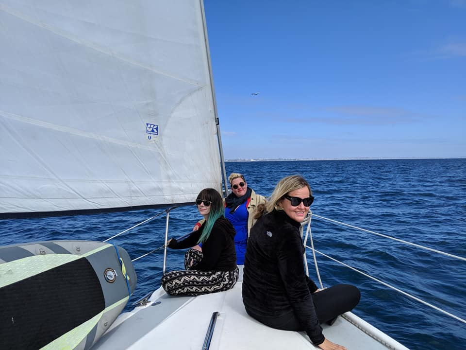 Sara Newton and friends on a sailboat.