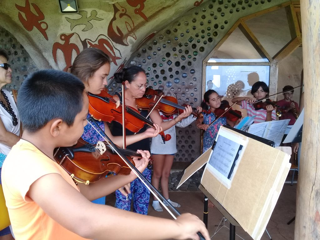 Toki's Music School students during violin lessons.
