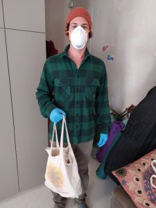 Mike Bilodeau in mask and glove to shop during pandemic