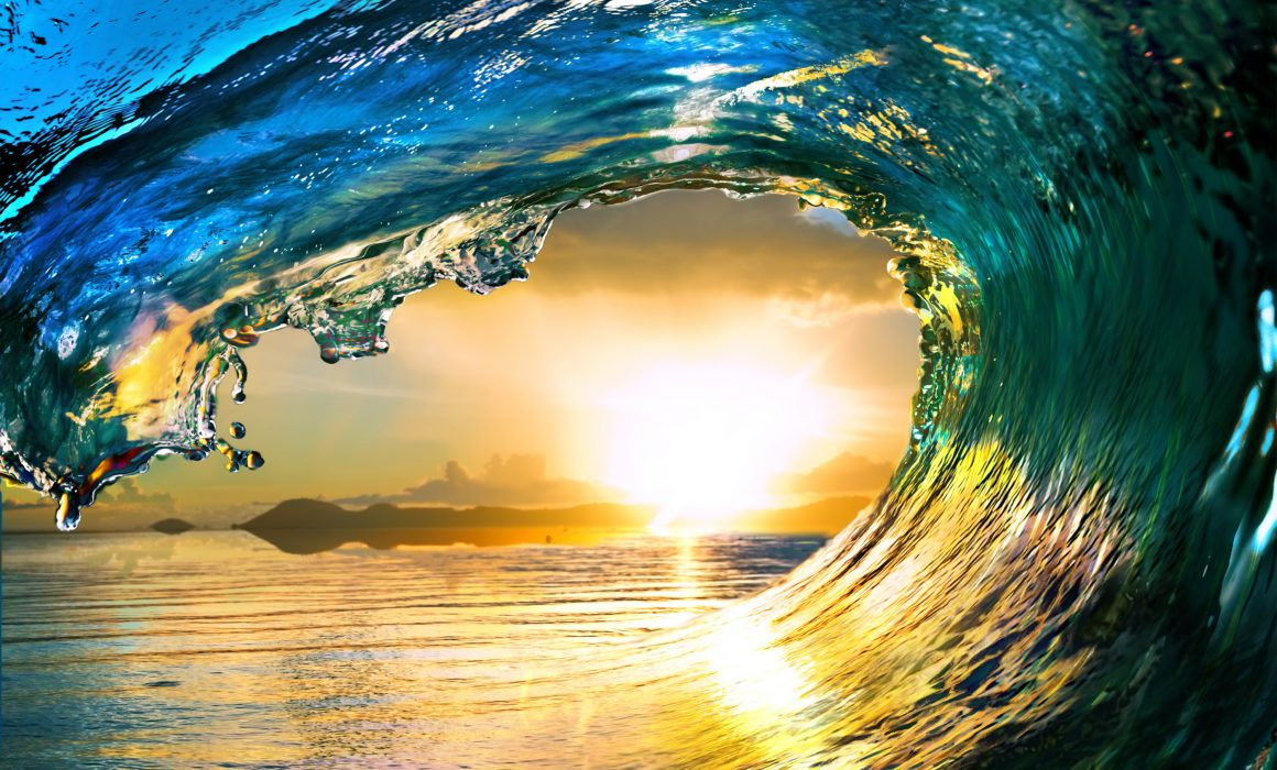 World Oceans Day: An Ocean Wave at Sunset