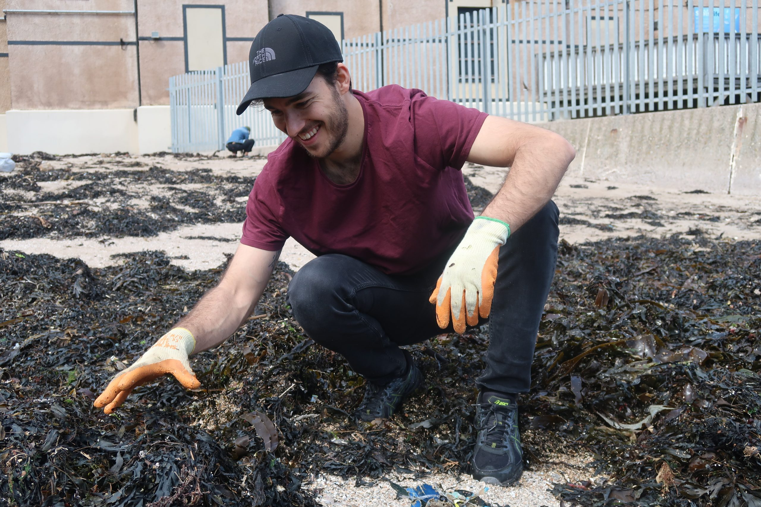 Juan Castano in action at a beach cleanup.