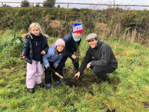 Tree planting family on
