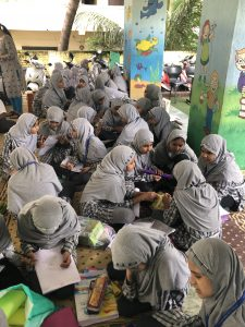 Young women attend a Blue Workshop.