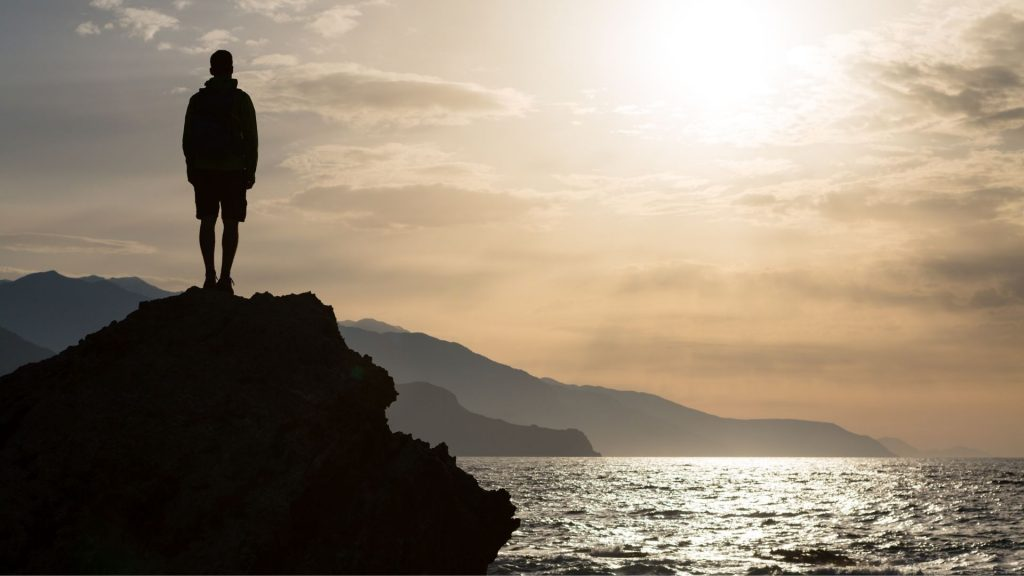 Man looking at the ocean on World Ocean Day